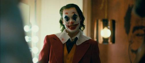 "National theater chains like Alamo Drafthouse are warning families that ""Joker"" is not a kid-friendly film. [Image Credit] Warner Bros/YouTube"