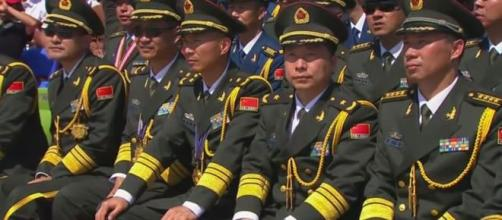 China marks 70th anniversary with a powerful military parade. [Image credit: YouTube/Washington Post]