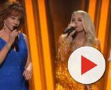Reba McEntire, Carrie Underwood, and Dolly Parton open the 2019 CMA Awards in dazzling tribute to female greats. [Image Source: CMAVEVO/YouTube]