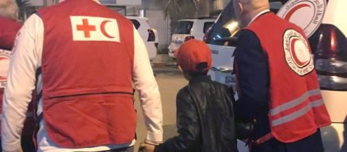 Albanian boy freed from IS camp on way home to Italy. [Image credit: Blasting News Database]