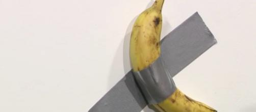 A banana taped on the wall sold for $120,000. Credit: Screencap/CBS News