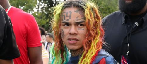 "An image of 6ix9ine from his music video ""TATI"" [image source: Worldstarhiphop- YouTube]"
