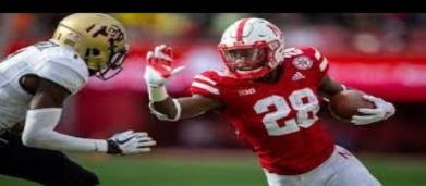 Nebraska football running back Maurice Washington will travel to California to surrender