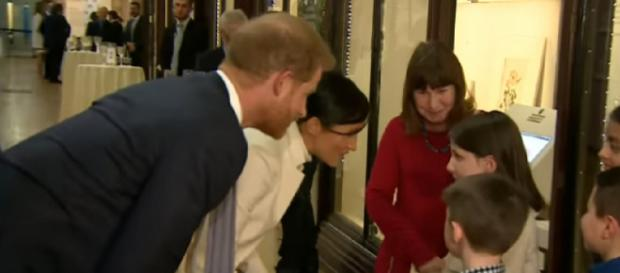Prince Harry and Meghan arrive at the Natural History Museum for a glam gala performance. [Image source/The Royal Family Channel YouTube video]