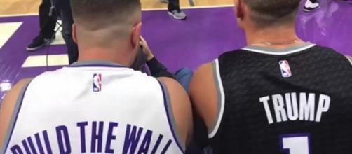 Sacramento Kings fans Daniel Goldsmith and Pete Molinelli wore controversial jerseys to game. [Image Source: Sacramento Bee - YouTube]