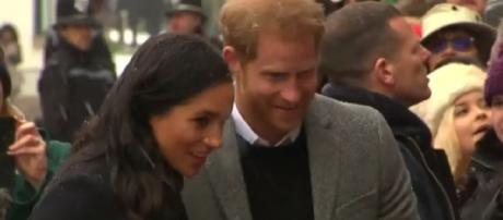 Prince Harry and Meghan Markle brave the snow to greet fans during royal visit to Bristol. [Image source/Global News YouTube video]