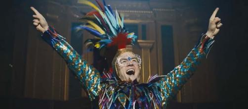 "Taron Egerton plays Elton John in the biopic ""Rocketman."" [Image We Got This Covered/YouTube]"