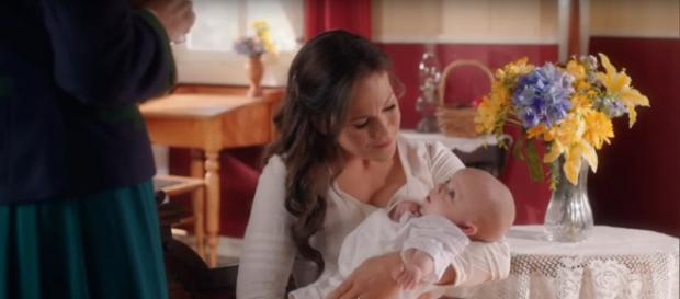 Elizabeth (Erin Krakow) has a hard time leaving baby Jack for her first day back to the classroom. [Image source:HallmarkChannel-YouTube]