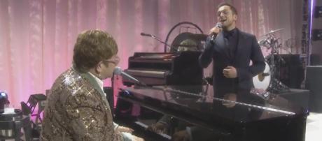 "Taron Egerton and Elton John sing a duet of ""Tiny Dancer."" [Image AMC Theatres/YouTube]"