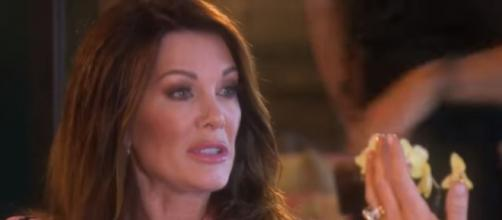 Lisa Vanderpump wine bottle signing - Image credit - Real Housewives of Beverly Hills Official Season 9 First Look | Bravo