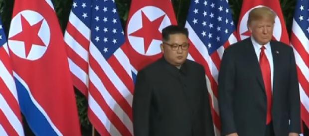 President Trump, Kim Jong Un meet in Singapore. [Image source/CNN YouTube video]