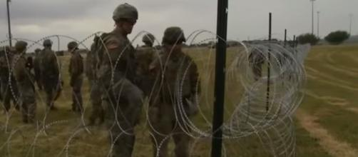 Military put up razor wire along Mexico border - Image credit - RT | YouTube