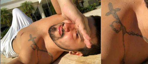 O cantor Luan Santana exibe tatuagem ao tomar sol (Reprodução/Instagram)