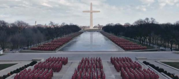 Handmaids gather together to protest in Washington, DC. [Image Hulu/YouTube]