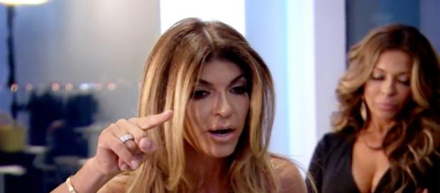 Teresa Giudice flips chairs. - [Bravo / RHONJ screencap]