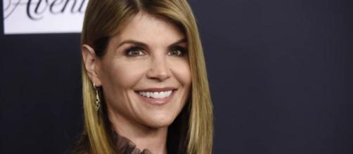 Actress Lori Loughlin fired from Hallmark channel's parent company over college cheating scandal. [Image Source: WKYC Channel 3 - YouTube]