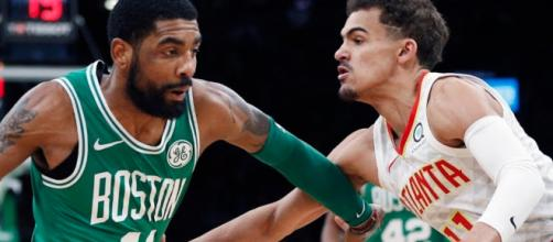 Kyrie Irving and Trae Young battled on the court in Boston on Saturday (Mar. 16). - [ESPN / YouTube screencap]