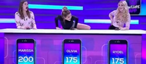 Olivia Jade Giannulli (center) reportedly won a rigged game show in 2016. [Source: Entertainment - YouTube]