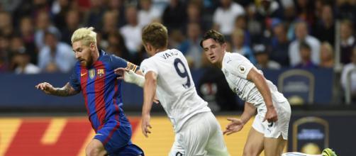 Messi, Suárez y Munir durante un partido de fútbol