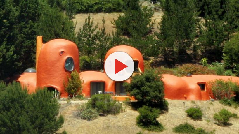 The Flintstone House owner sued over highly visible eyesore