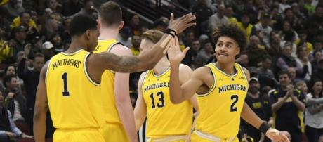 The Wolverines open against Montana in NCAA Tournament play tonight. [Image via USA Today Sports/YouTube]