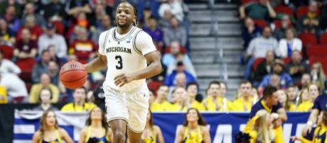 Zavier Simpson and the Wolverines are now set at 8/1 odds to win the NCAA Title. [Image via Mlive/YouTube]