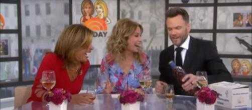 Joel McHale toasts Kathie Lee Gifford and Hoda Kotb with something harder on 'Today.' - [TODAY / YouTube screencap]