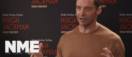 Hugh Jackman goes singing and dancing in world tour. [Source: NME/YouTube]