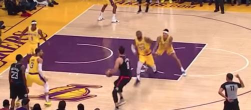 A play during Monday's Lakers game involved Kyle Kuzma shoving LeBron into defensive position. [Image via NBA/YouTube]