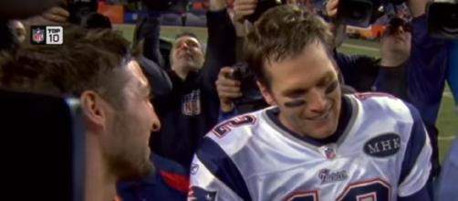 Tebow and Brady chat after the Patriots beat the Broncos in the 2011 AFC Divisional Game. [Image Credit: NFL Films/YouTube]