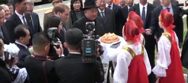 Kim Jong Un greeted with bread and flowers as he arrives in Russia for Putin meeting. [Image source/euronews (in English) YouTube video]