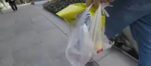 NY to ban plastic bags & charge traffic tax. [Image source/RT America YouTube video]