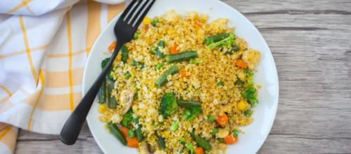 Couscous with vegetables top view. [Source: Marco Verch - Flickr]