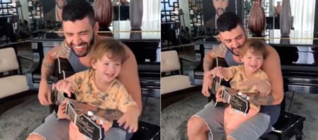 O cantor se diverte tocando um de seus sucessos para o herdeiro. (Reprodução/Instagram/@gusttavolima)