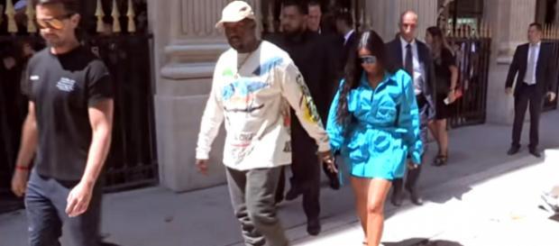 Surrogate mother births Kim Kardashian's and Kanye West's new baby boy. - [Image source: HollywoodLife/YouTube screencap]