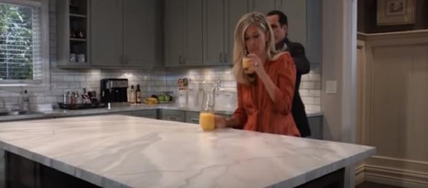 Carly drinking orange juice. - [General Hospital / YouTube screencap]