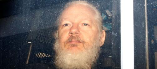Assange leaving the Ecuadorian embassy. [Blasting News Database]