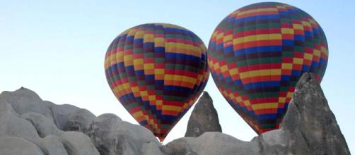 Take a hot air balloon ride to Cappadocia in Turkey. [Image Ahsioz/Wikimedia Commons]