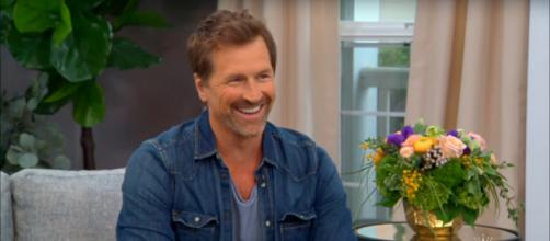 Being engaged gives Paul Greene a great reason to smile. - [HallmarkChannel / YouTube screencap]