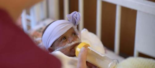 The world's tiniest baby has survived and has gone home to her parents. [Image Sharp HealthCare/YouTube]