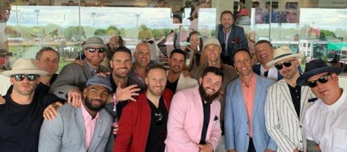 Baker Mayfield (in pink suit) poses for photo with Tom Brady and other Patriots (Image Credit: Jacoby Brissett/Instagram)