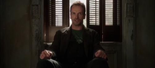 Sherlock wakes up Watson. - [CBS / YouTube Screencap]