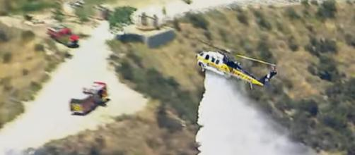 Los Angeles-area amusement park evacuated due to fire. [Image source/ABC News YouTube video]