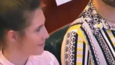 Amanda Knox wipes away a tear in Modena