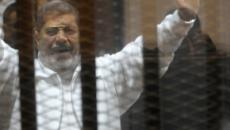 Deposed Egyptian President Morsi dies inside his cage during trial in Cairo