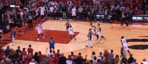 Andre Iguodala readies his game-ending shot to clinch Warriors' Game 2 win over Raptors, 109-104. [Image source: NBA/YouTube/Screenshot]