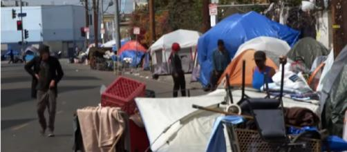 In LA, poverty on Skid Row defies US' humane reputation. [Image source/PBS NewsHour/YouTube video]