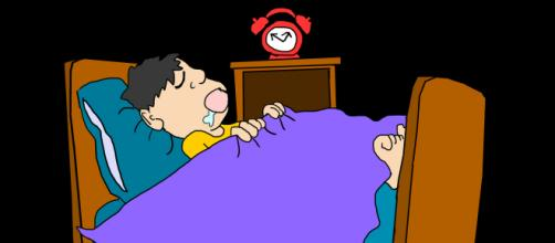 A cartoon man sleeping - image credit: LillyCantabile via Pixabay.com.