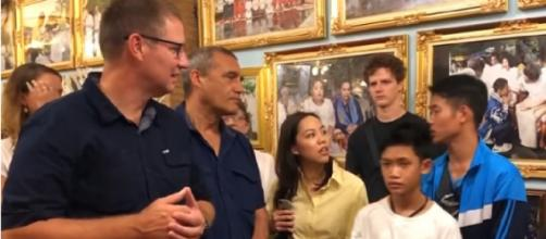Thai soccer team reunites with some divers who helped save them from the cave. [Image source/Global News YouTube video]