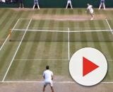Federer going after Djokovic serve late in the fifth set. [Image Source: Wimbledon / YouTube]
